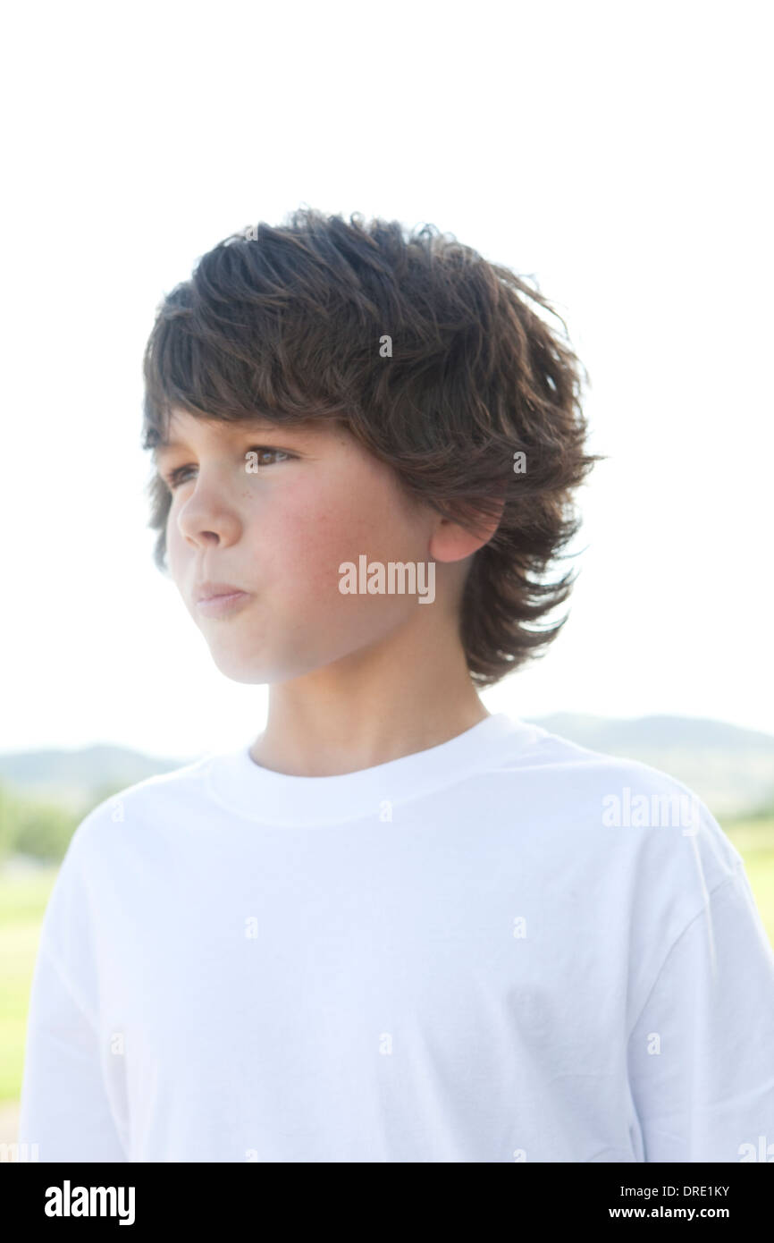 Young boy in white tee shirt - Stock Image