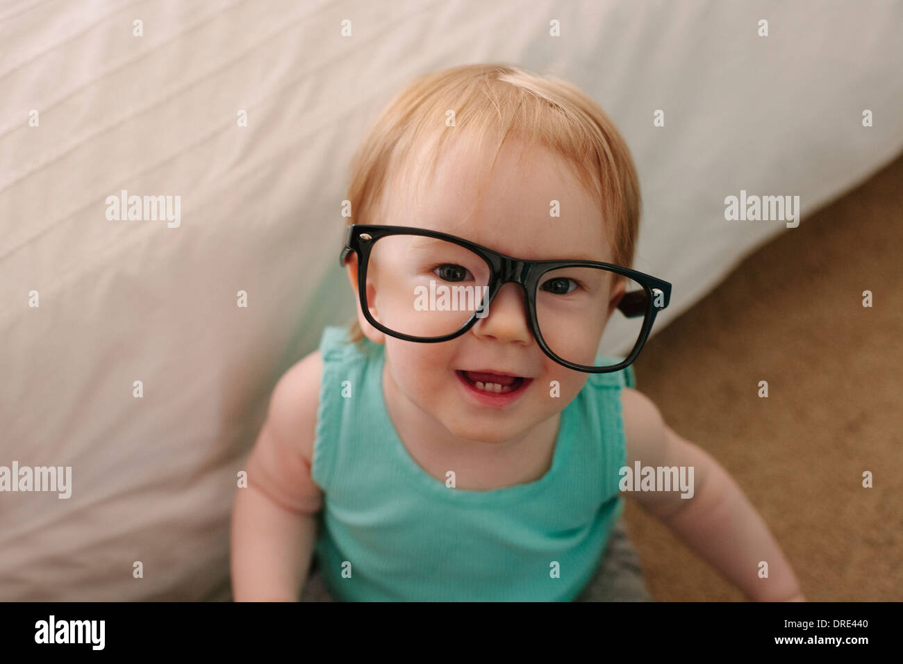 Young baby wearing glasses Stock Photo