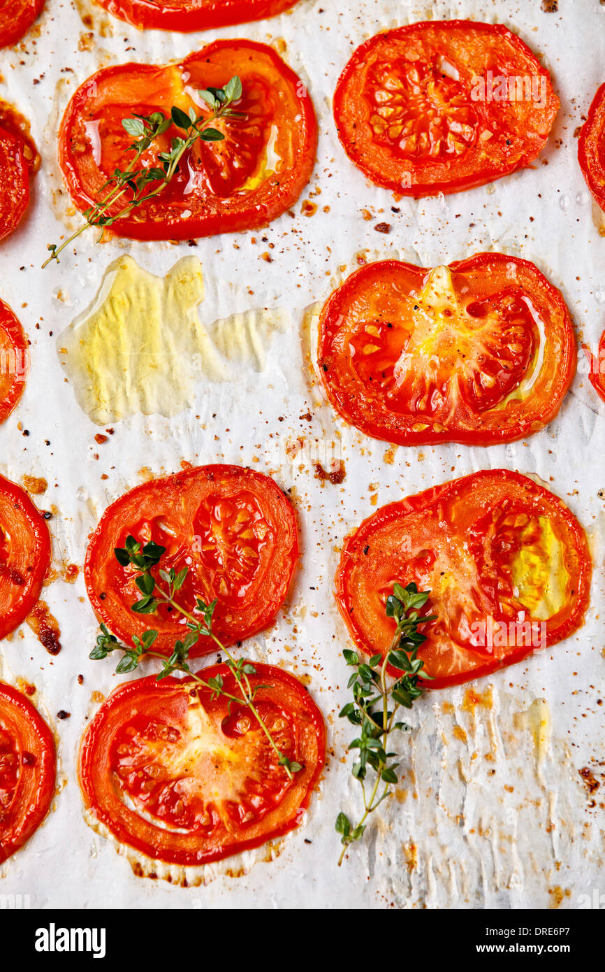 Baked tomatoes on textured background - Stock Image
