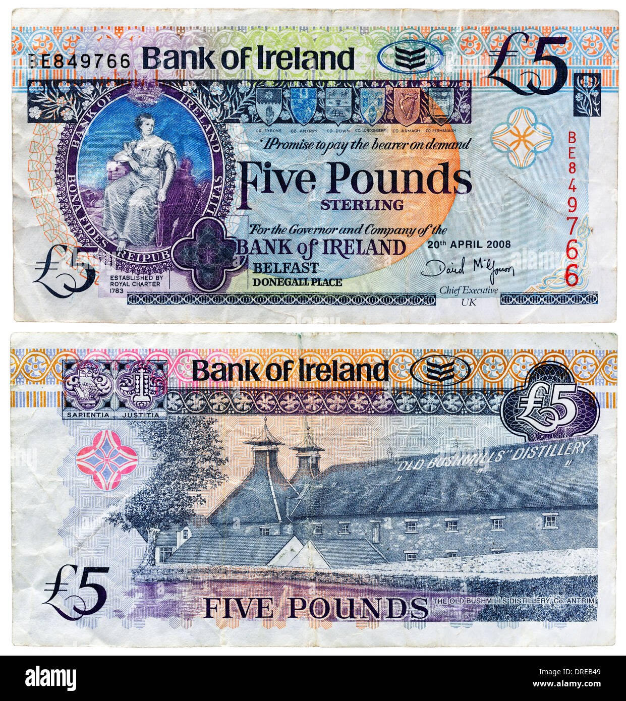 5 Pounds banknote, Hibernia seated and Old Bushmills Distillery, Northern Ireland, 2008 - Stock Image
