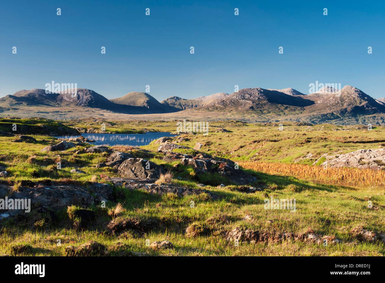 View from Arkeen More, towards the Twelve Bens mountain range, Connemara, County Galway, Ireland - Stock Image