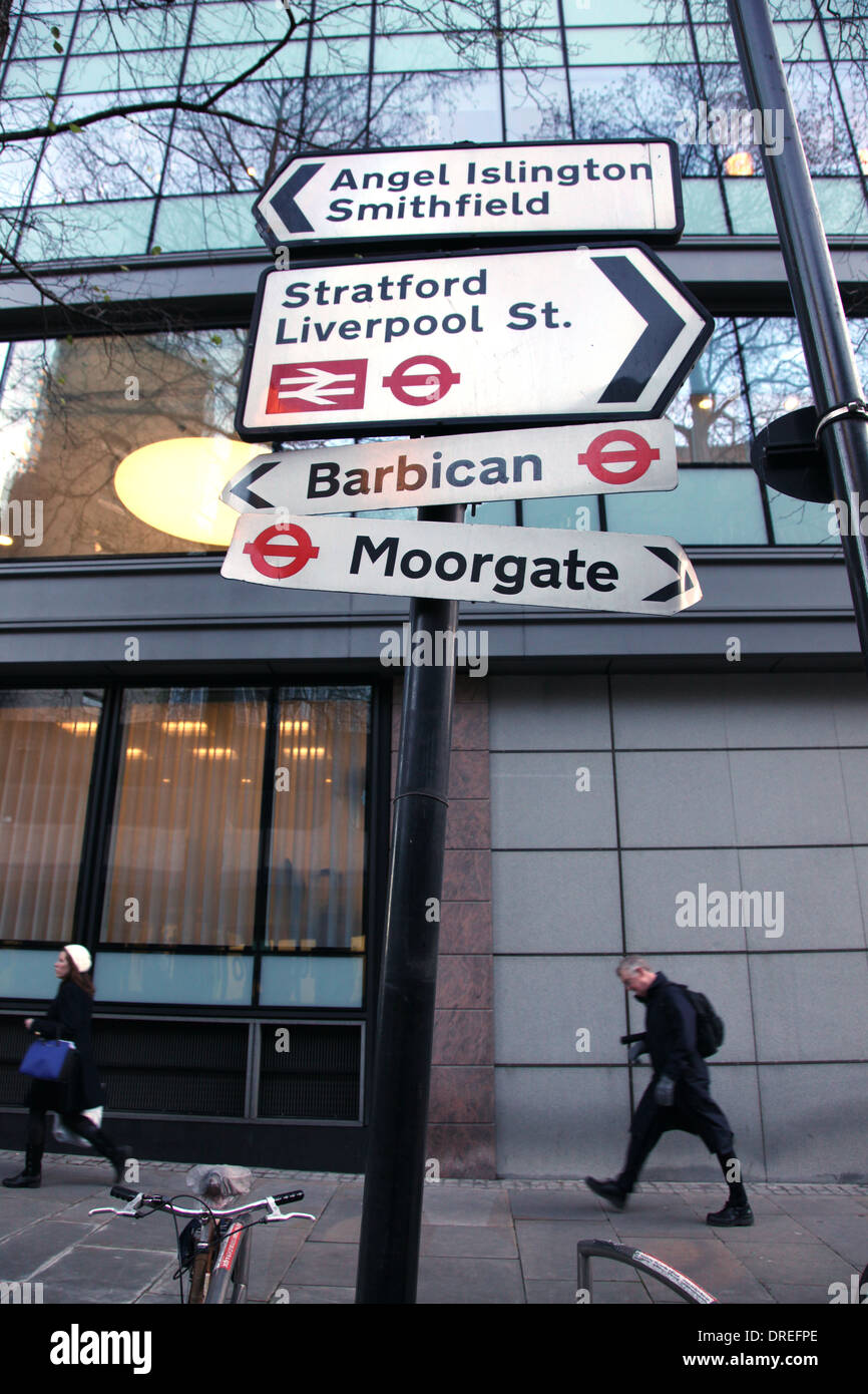 Street signs pointing to places and stations in the City of London - Stock Image