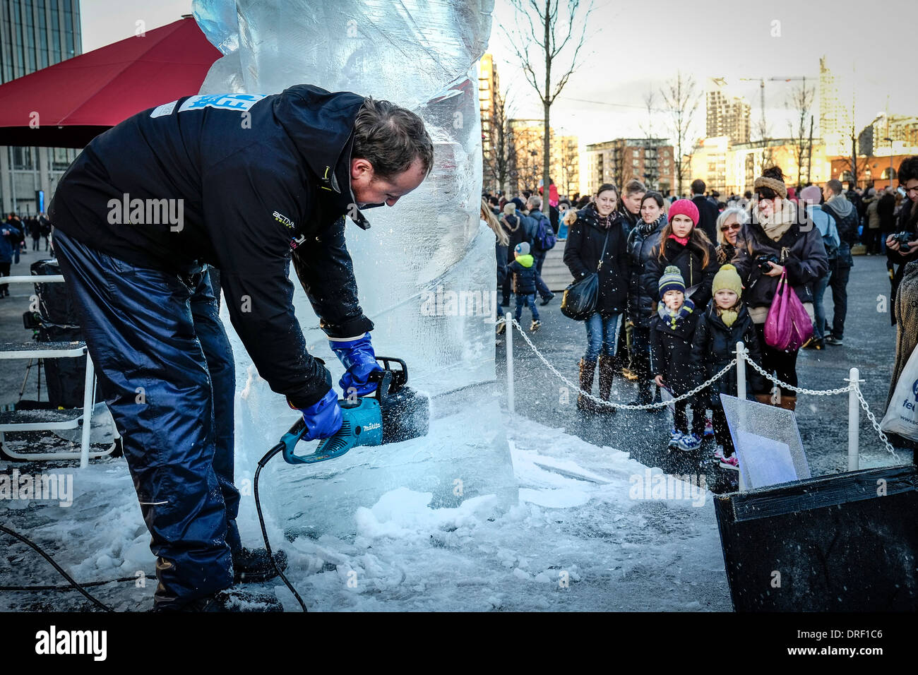 An artist working to create a sculpture as part of the London Ice Sculpture Festival 2014. - Stock Image