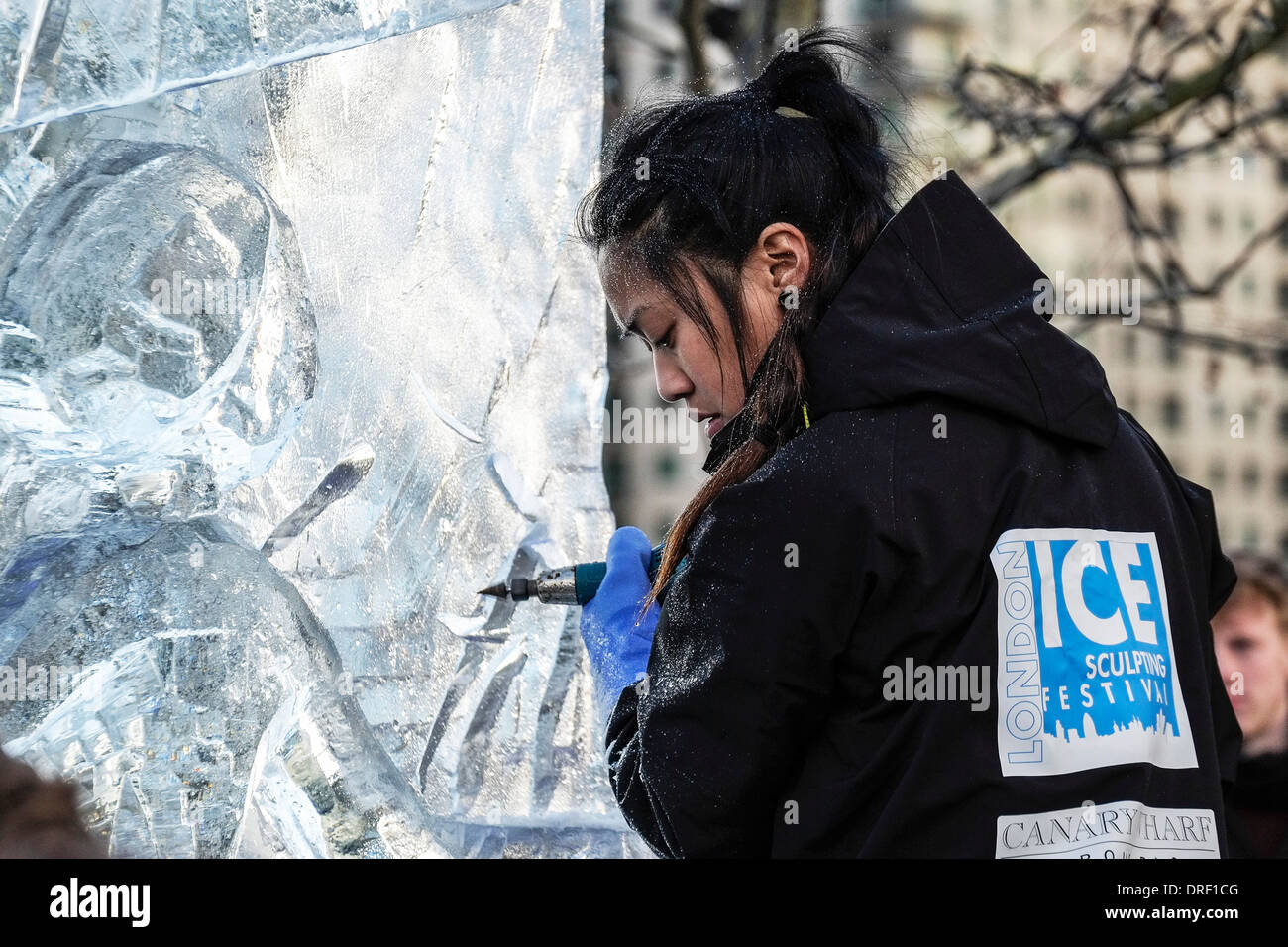 A member of the British team working to create their sculpture as part of the London Ice Sculpture Festival 2014. - Stock Image
