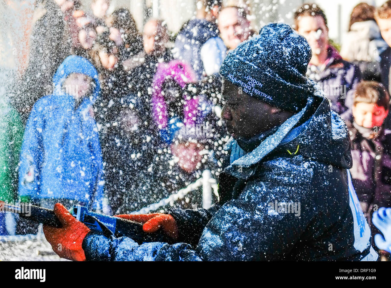 Mario Amagee from the African team working to create a sculpture as part of the London Ice Sculpture Festival 2014 - Stock Image