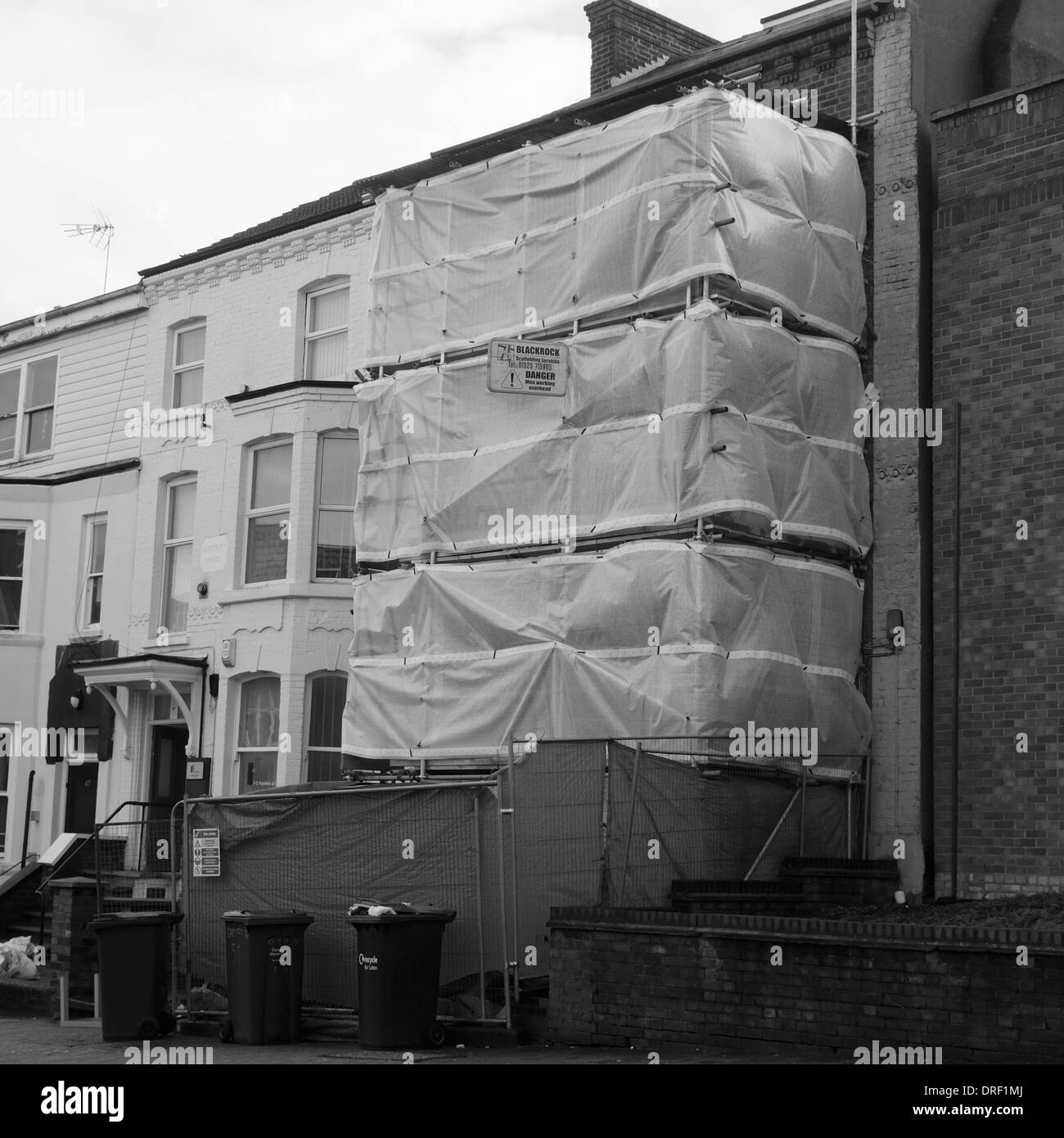 Scaffolding and screening  at a house in Luton - Stock Image