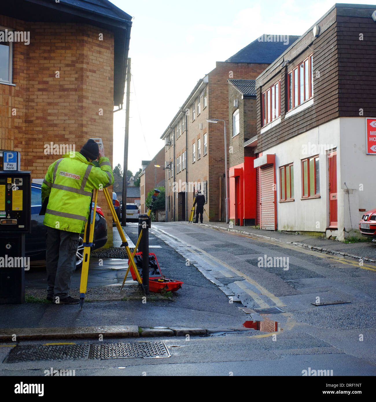 Street Surveyors making measurements on a street in Luton - Stock Image