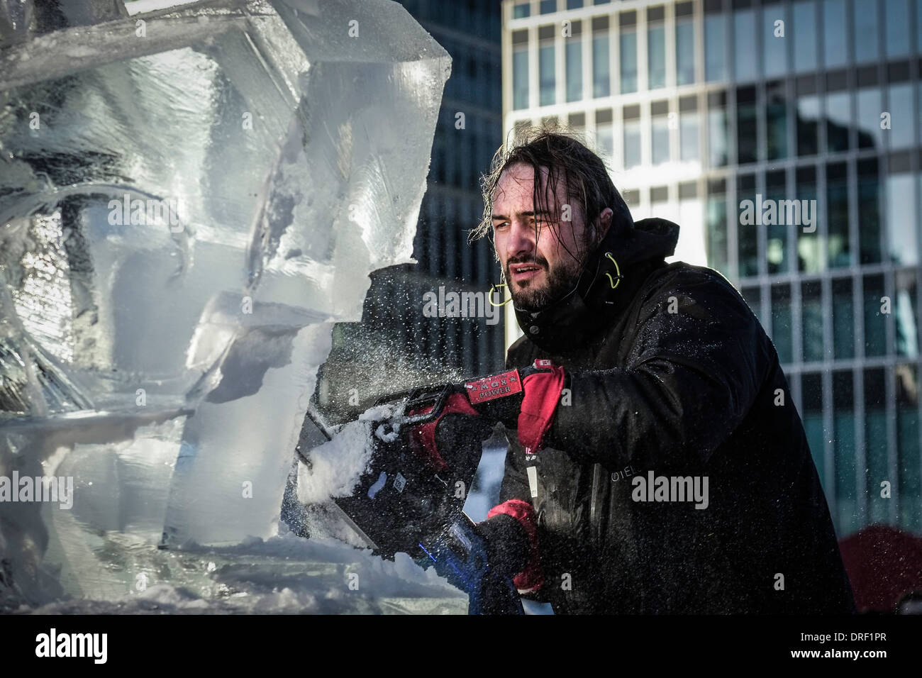 Bruno Fleurit from the the Spanish team creating their sculpture as part of the London Ice Sculpture Festival. - Stock Image