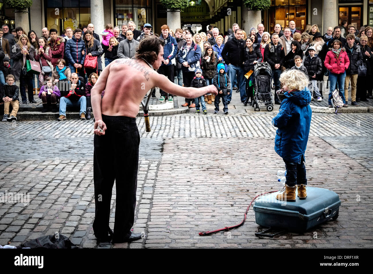 A street entertainer at Covent Garden Piazza. - Stock Image
