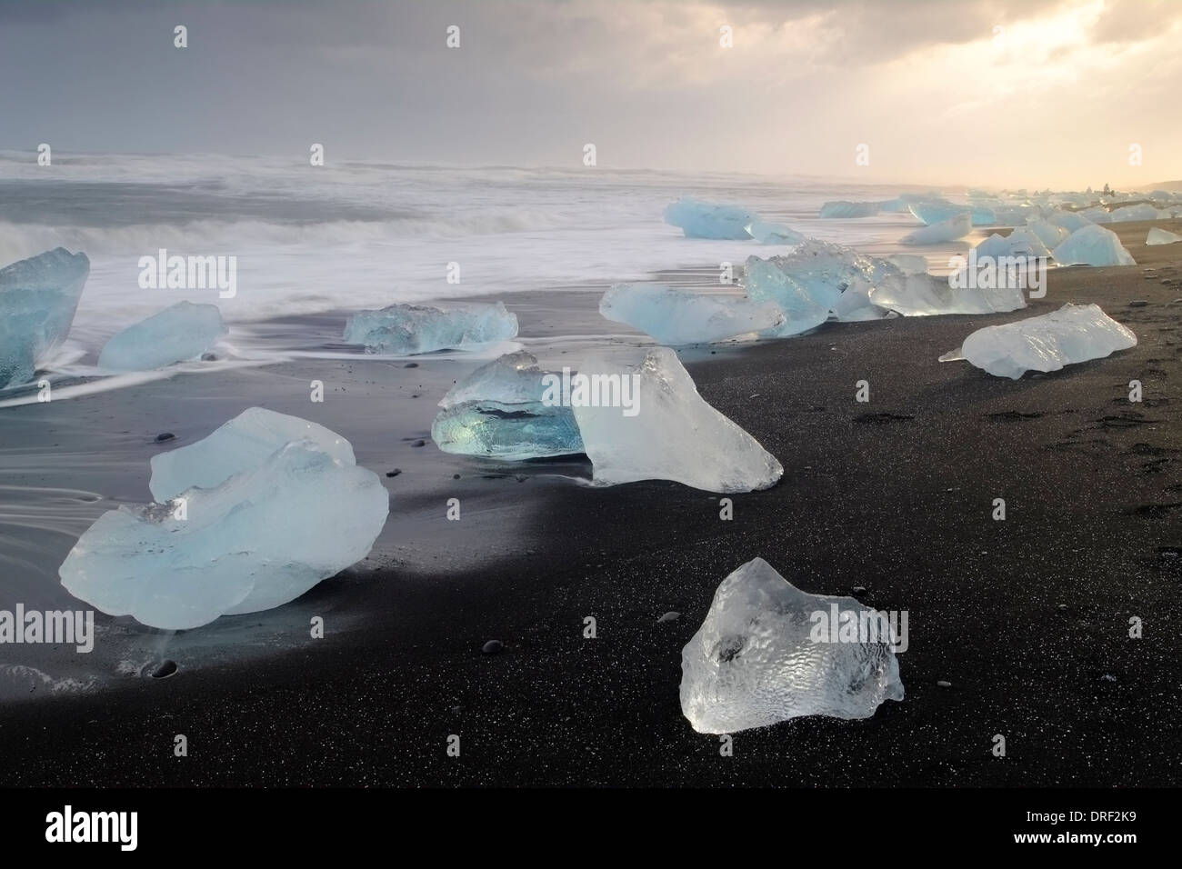 Icebergs on volcanic sands, Jokulsarlon, Iceland, Polar region - Stock Image