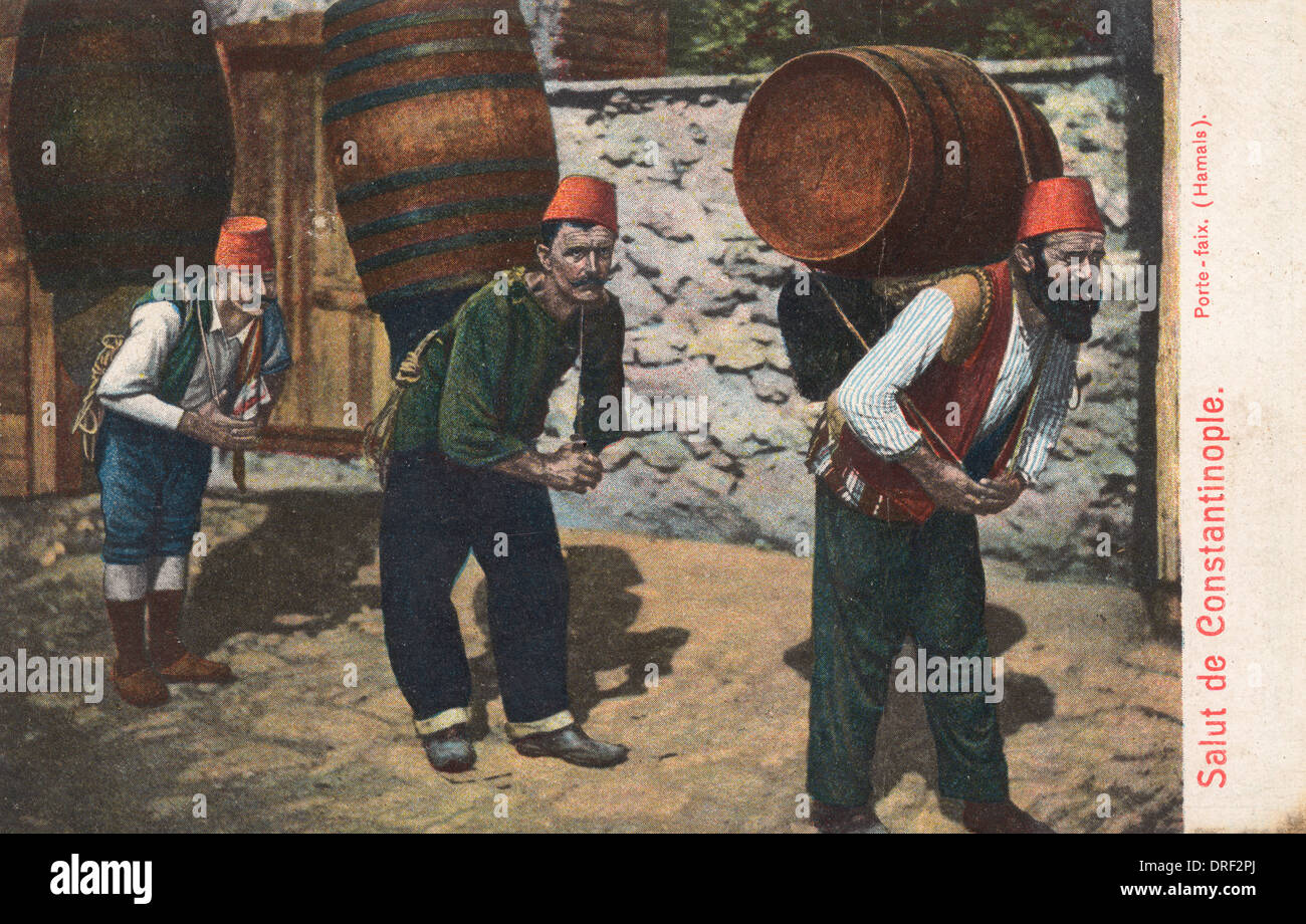 Porters carrying barrels - Istanbul, Turkey - Stock Image