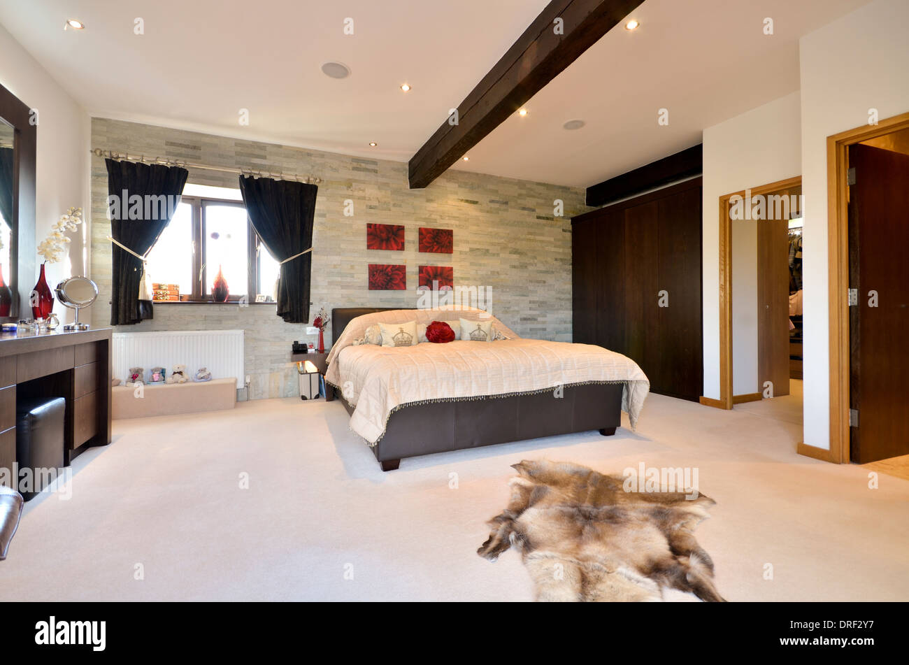 stylish master bedroom with ensuite and dressing room Stock ...