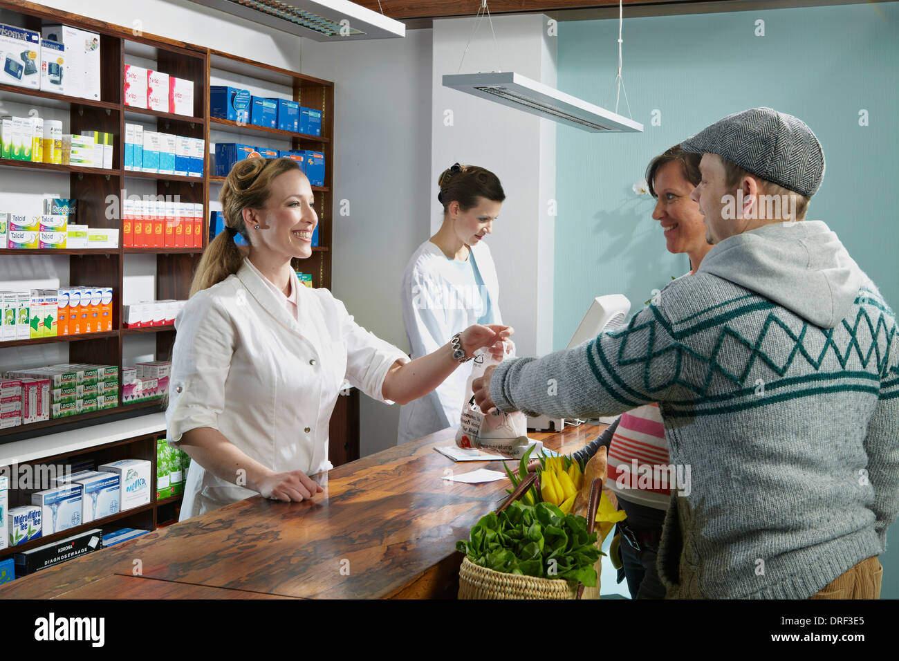 Couple in Drugstore, Munich, Bavaria, Germany - Stock Image