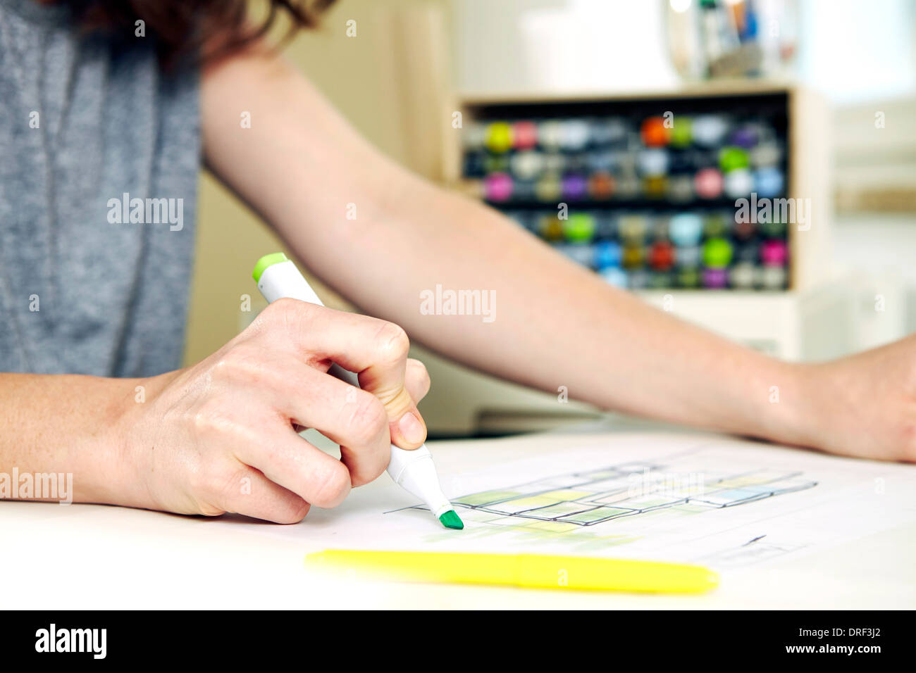 Woman works at desk, making notes, Munich, Bavaria, Germany - Stock Image