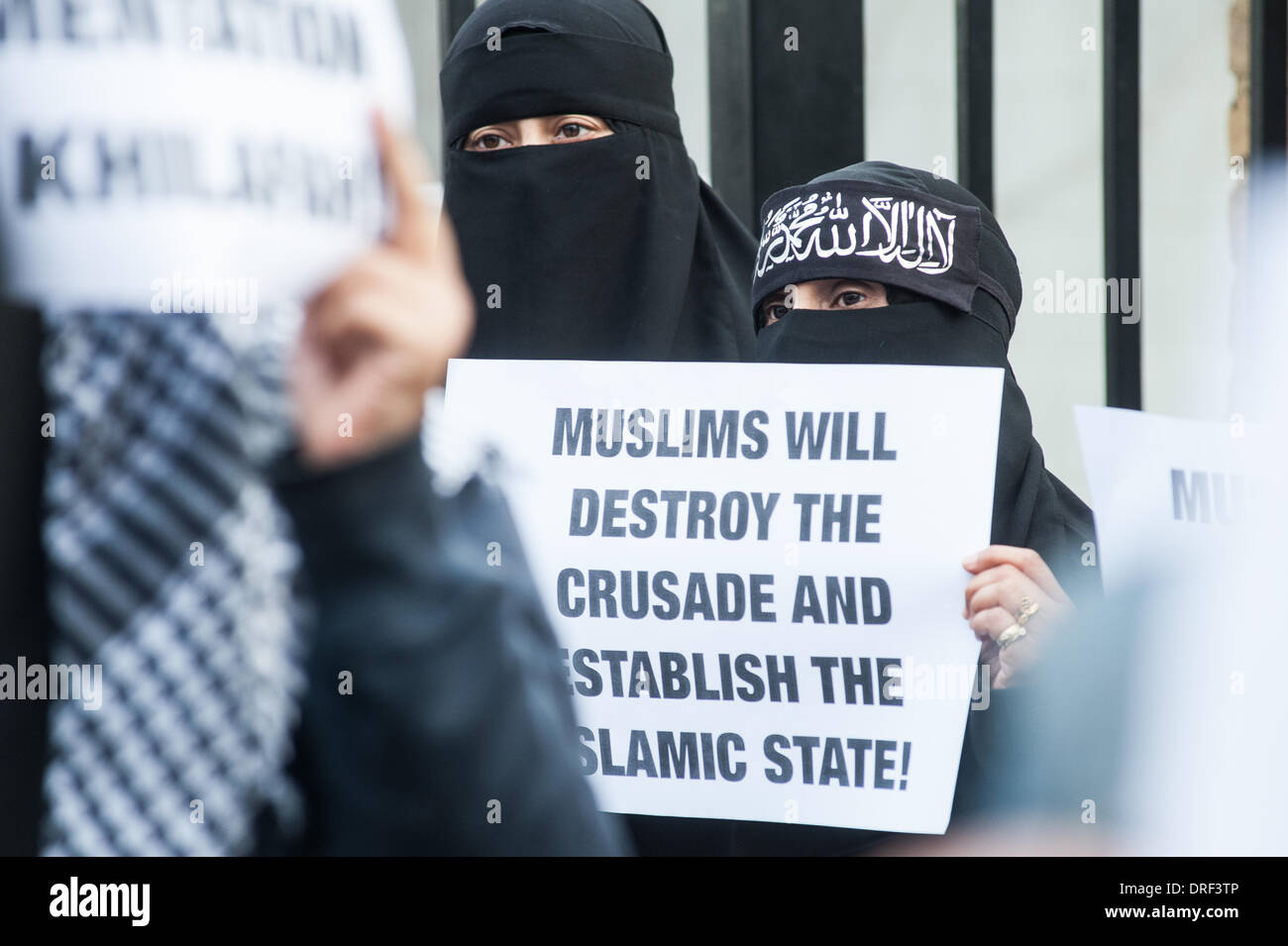 """London, UK. 24th January 2014. a protester holds a placard reading """"Muslims will destroy the crusade and estabilish Stock Photo"""