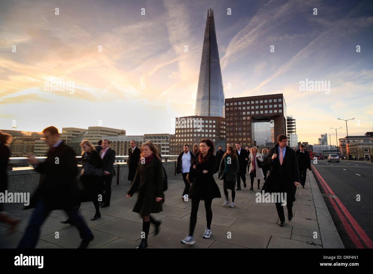 Commuters on London Bridge, morning rush hour, London Stock Photo