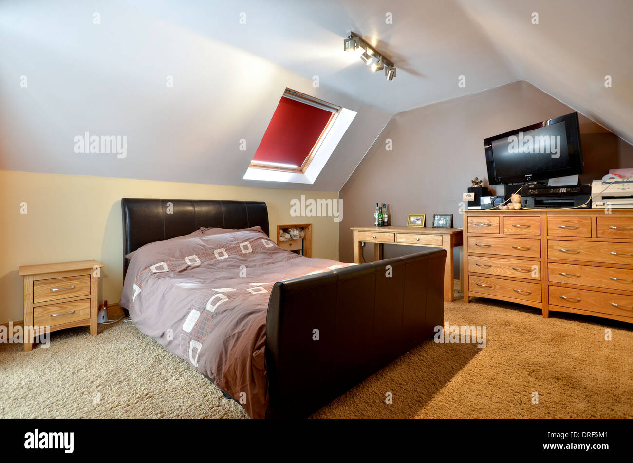 Attic Bedroom with skylight - Stock Image