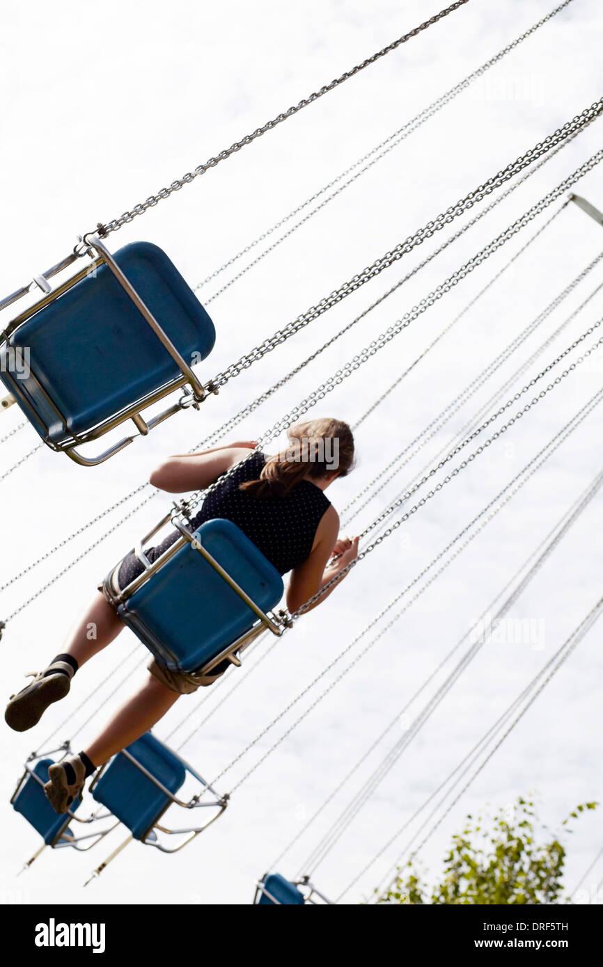 Girl Sitting in Amusement Park Ride, Bad Woerishofen, Bavaria, Germany, Europe - Stock Image