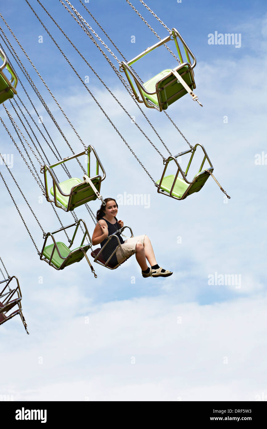 Gril Sitting in Amusement Park Ride, Bad Woerishofen, Bavaria, Germany, Europe - Stock Image