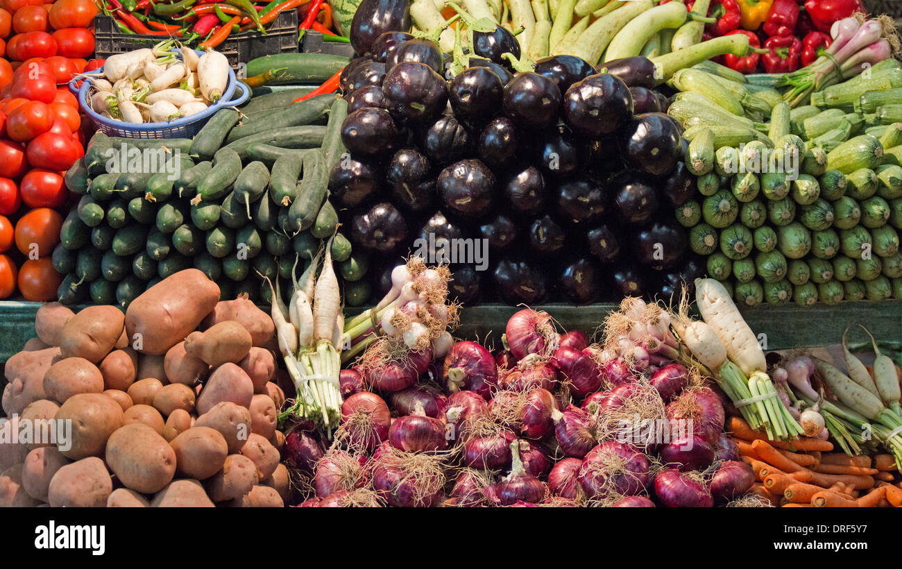 a display of fine quality vegetable produce for sale on a stall in the Tangier souk - Stock Image
