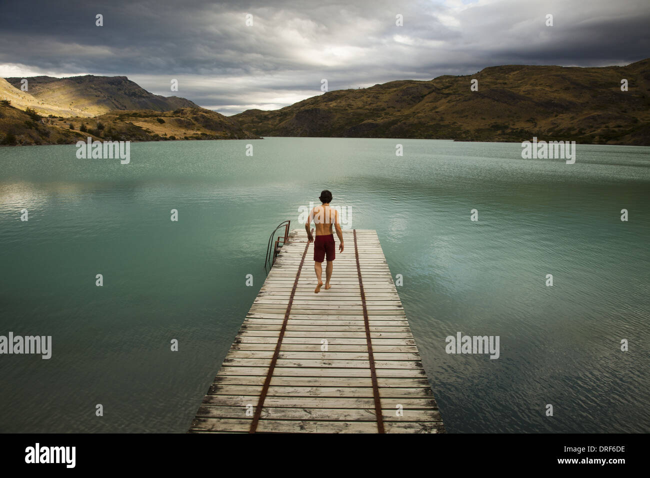 Torres del Paine National Park Chile. young man pier jetty lake Torres del Paine chile - Stock Image