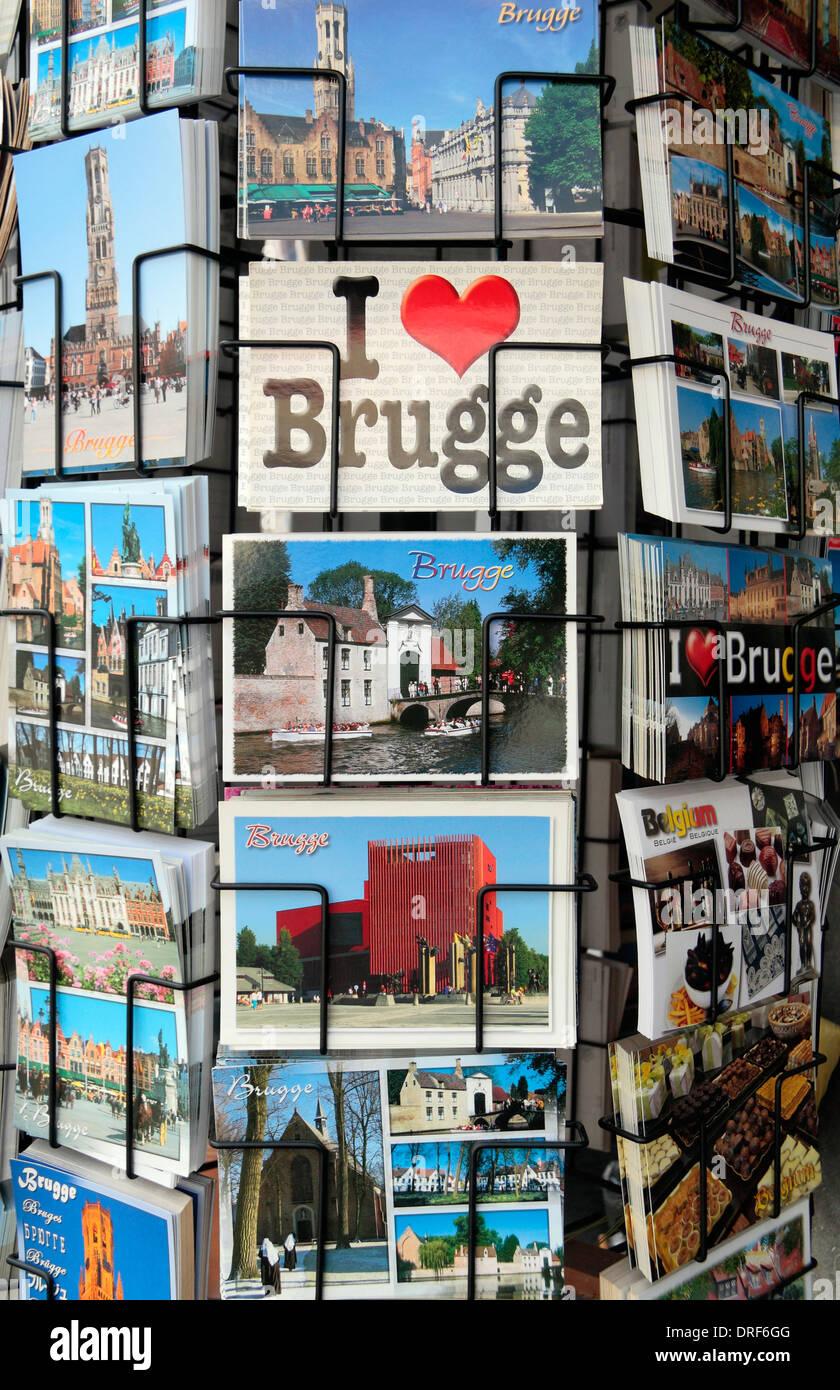 """A """"I love Brugge"""" postcard on a rotating shop postcard rack in historic Bruges (Brugge), West Flanders, Belgium. Stock Photo"""