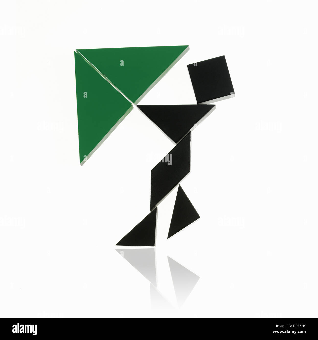 triangles squares shapes person action - Stock Image