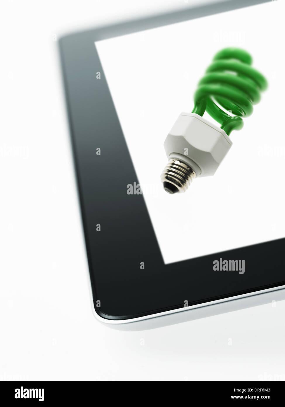 coiled element of lightbulb coloured green symbol - Stock Image