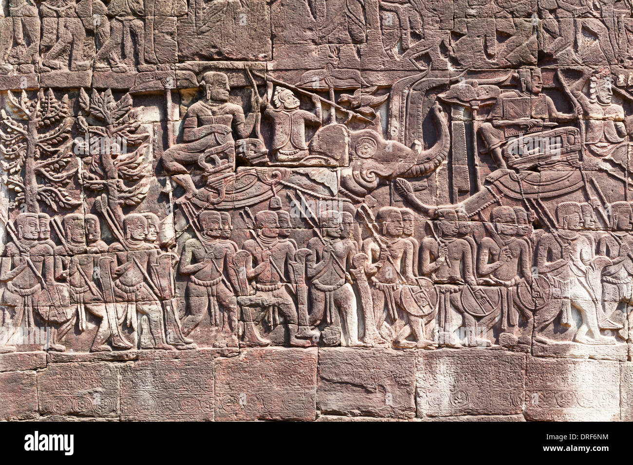 Bas reliefs on the west side of the Bayon temple, Cambodia - Stock Image
