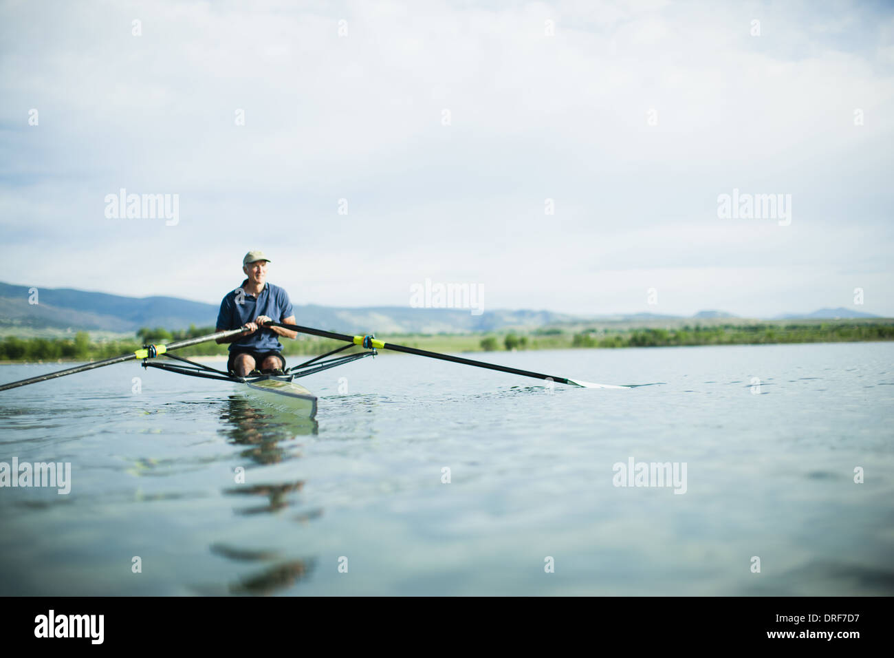 Colorado USA man in rowing boat using the oars Stock Photo