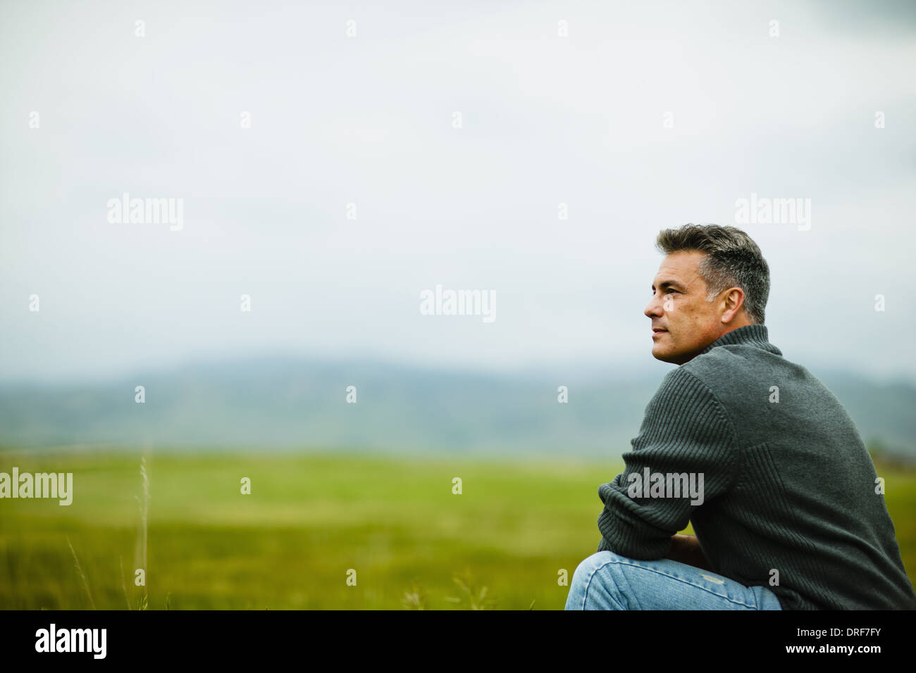 Colorado USA man sitting alone gazing deep in thought - Stock Image