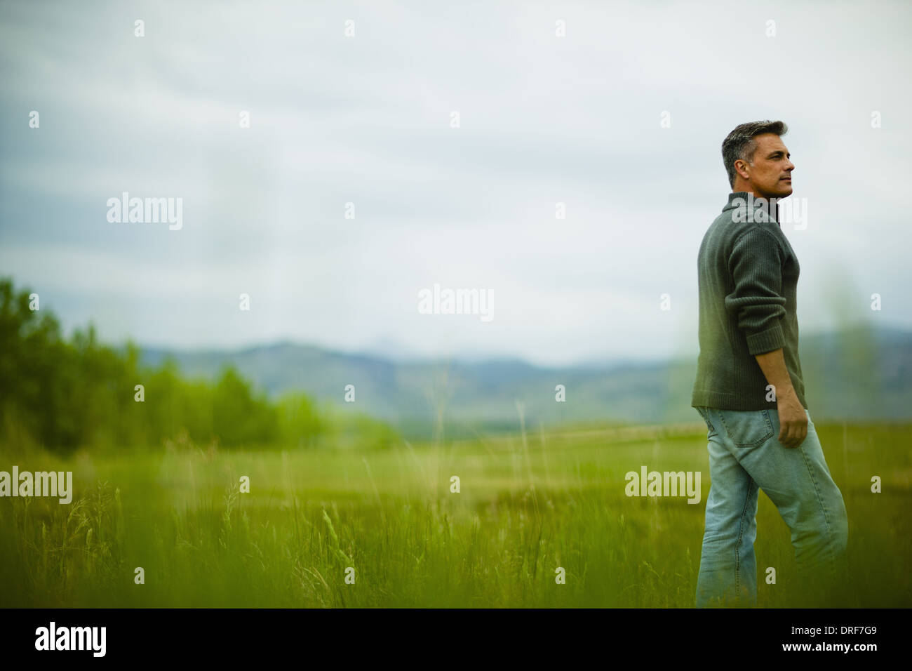 Colorado USA man standing looking into distance deep in thought - Stock Image