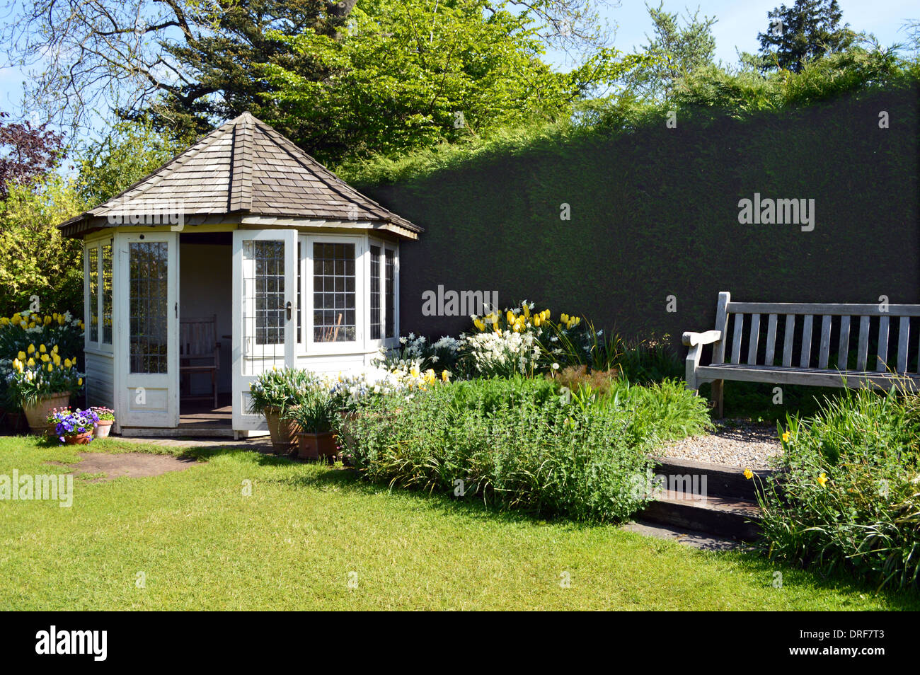 Summerhouse & Bench in a Conventional Garden on Display at the RHS Garden Harlow Carr, Harrogate, Yorkshire. - Stock Image