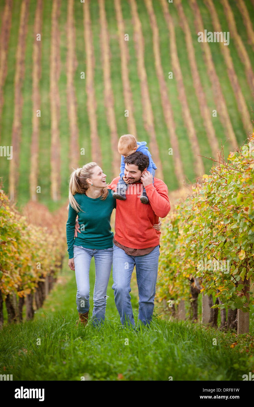 Family with one child walking in a vineyard, Osijek, Croatia - Stock Image