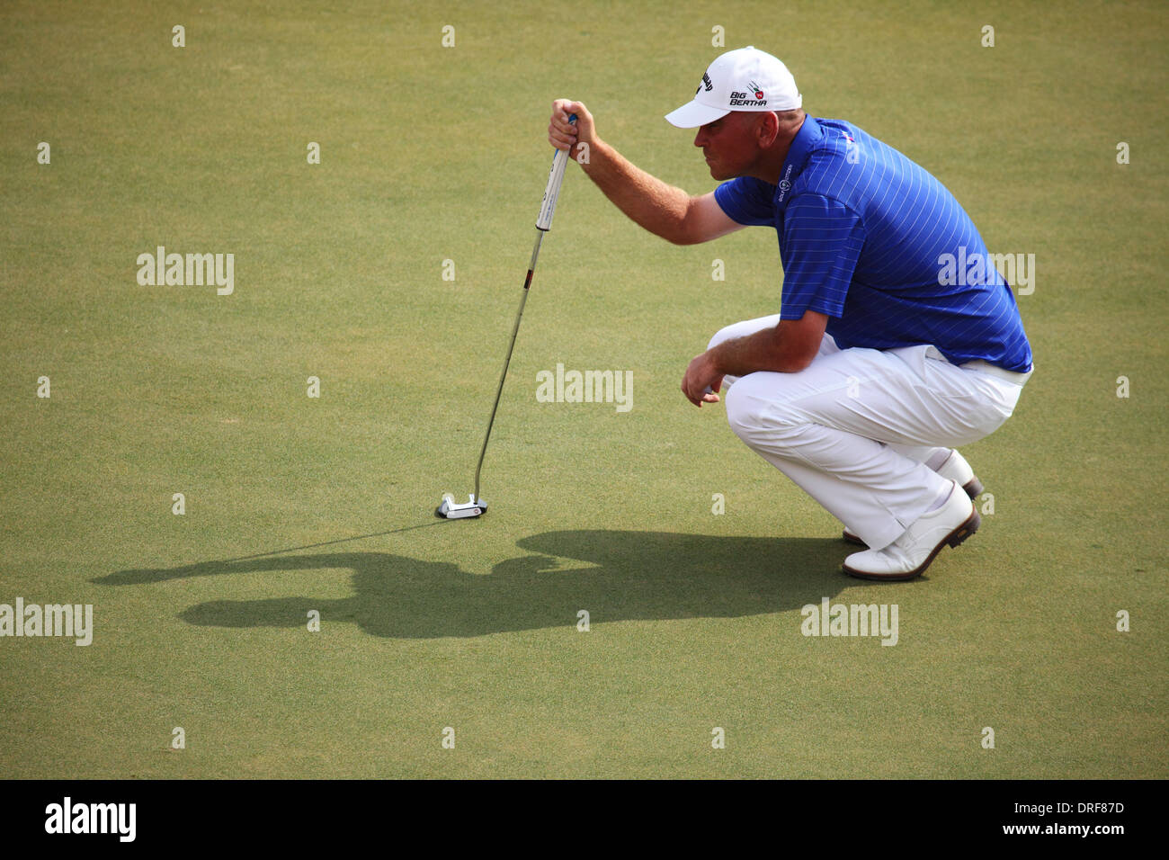 Thomas Bjørn playing in the 2014 Abu Dhabi HSBC Golf Championship. The championship is a PGA European Tour event. - Stock Image