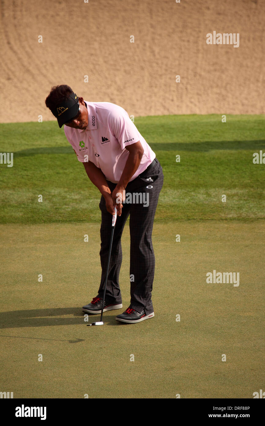 Thongchai Jaidee playing in the 2014 Abu Dhabi HSBC Golf Championship. The championship is a PGA European Tour event. - Stock Image