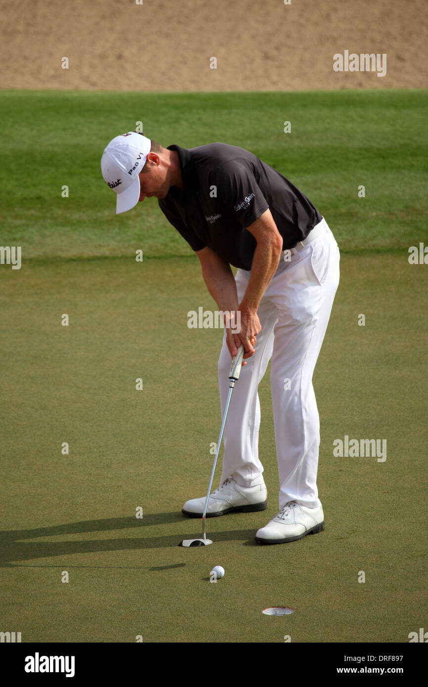 Michael Hoey playing in the 2014 Abu Dhabi HSBC Golf Championship. The championship is a PGA European Tour event. - Stock Image
