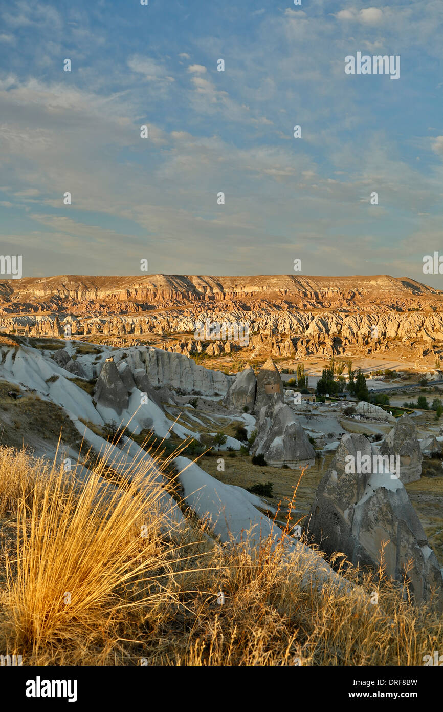 Badlands, fairy chimneys and mesa, near Goreme, Cappadocia, Turkey - Stock Image