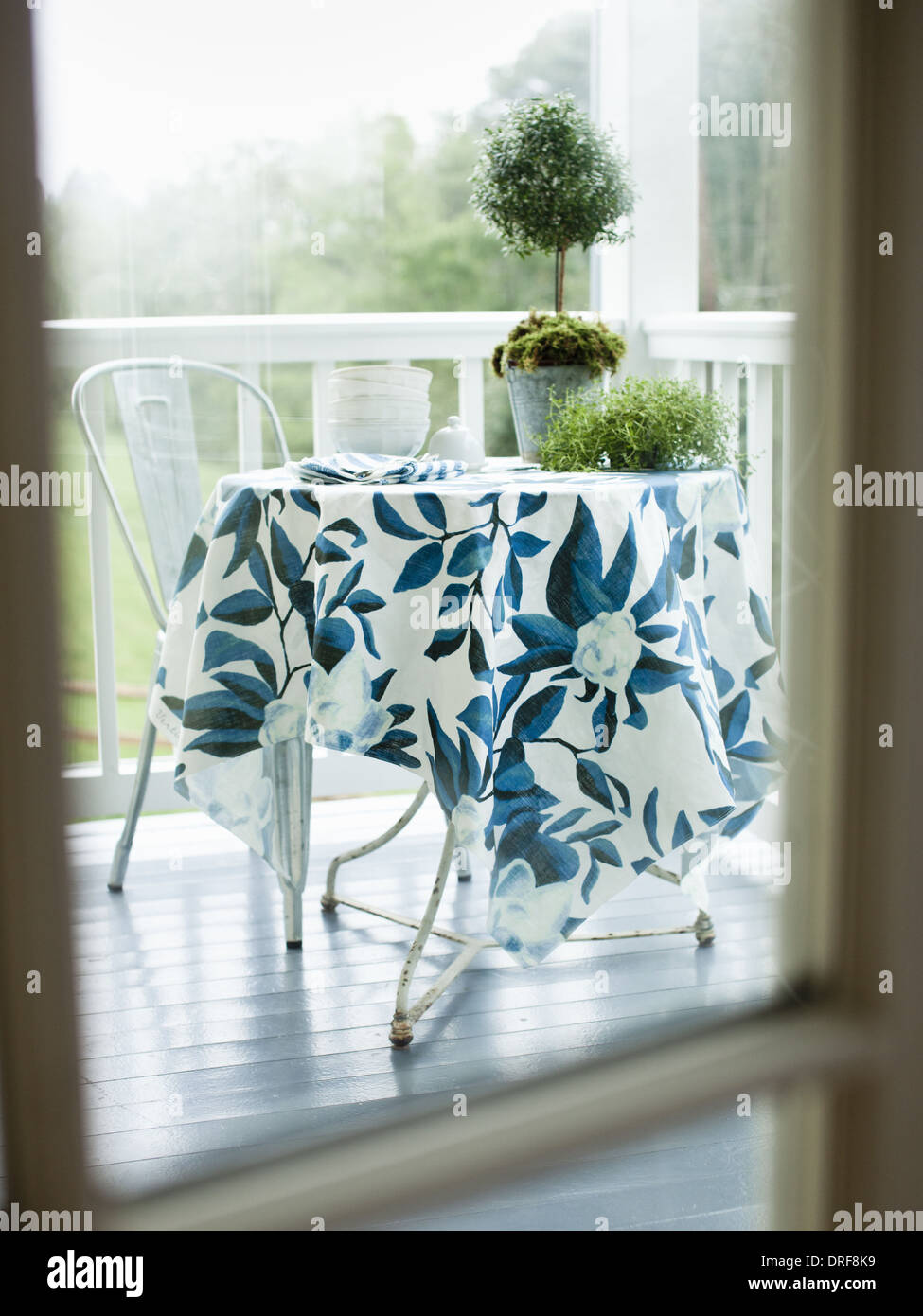 Maryland USA table and chair on white painted house porch - Stock Image
