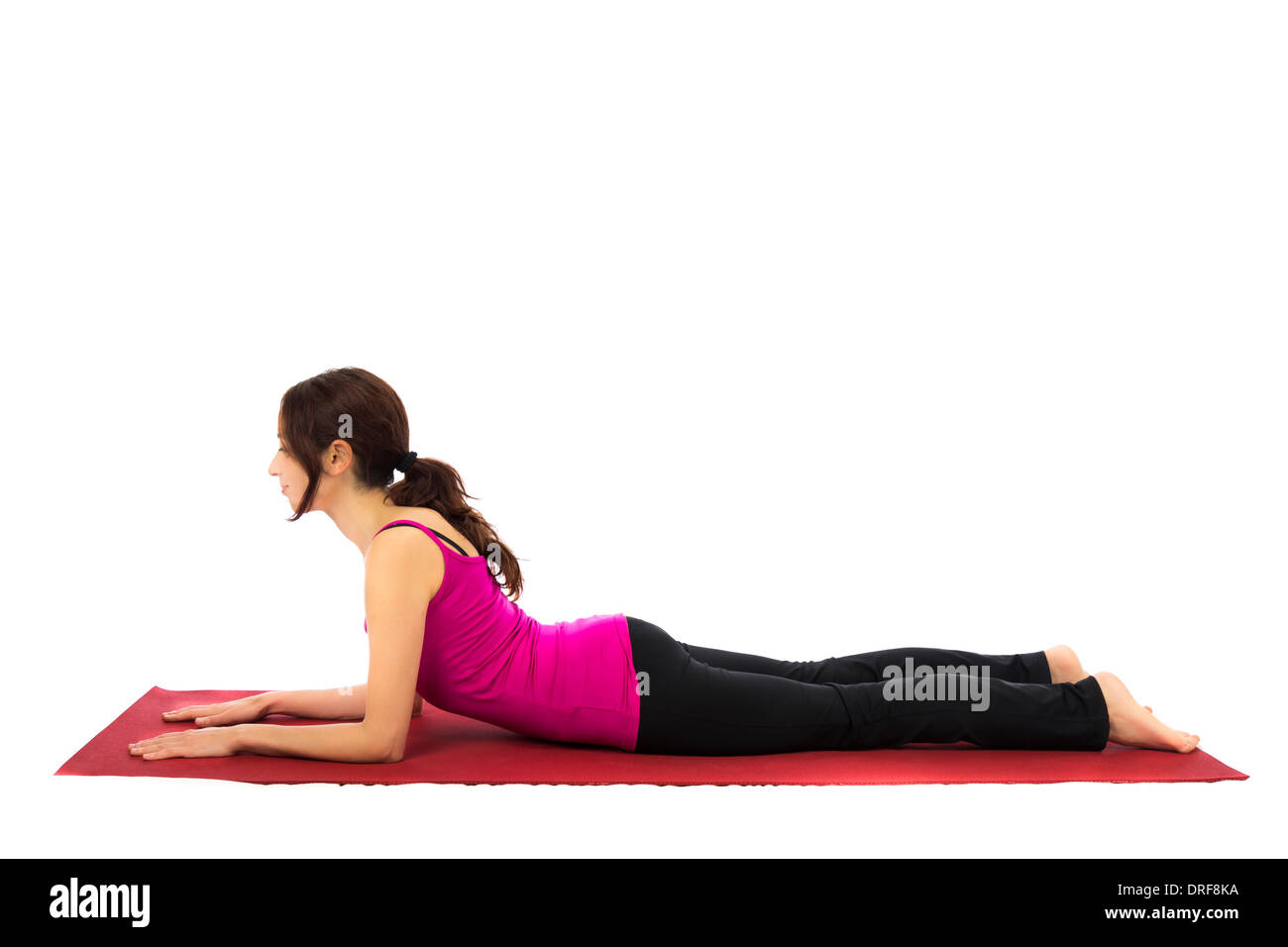 Young woman doing Sphinx Pose in Yoga (Series with the same model