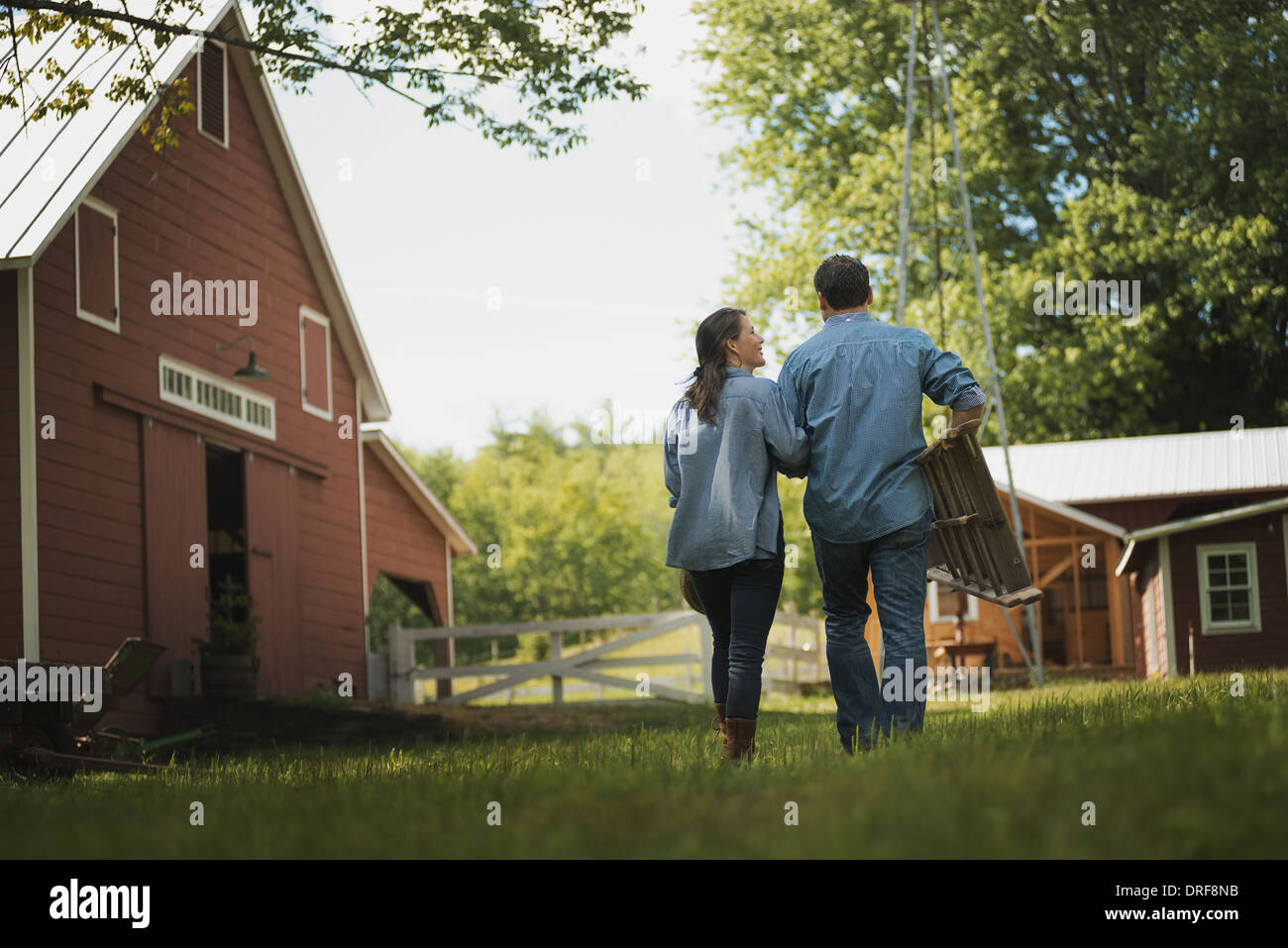 New York state USA Two people man and woman yard traditional farm Stock Photo