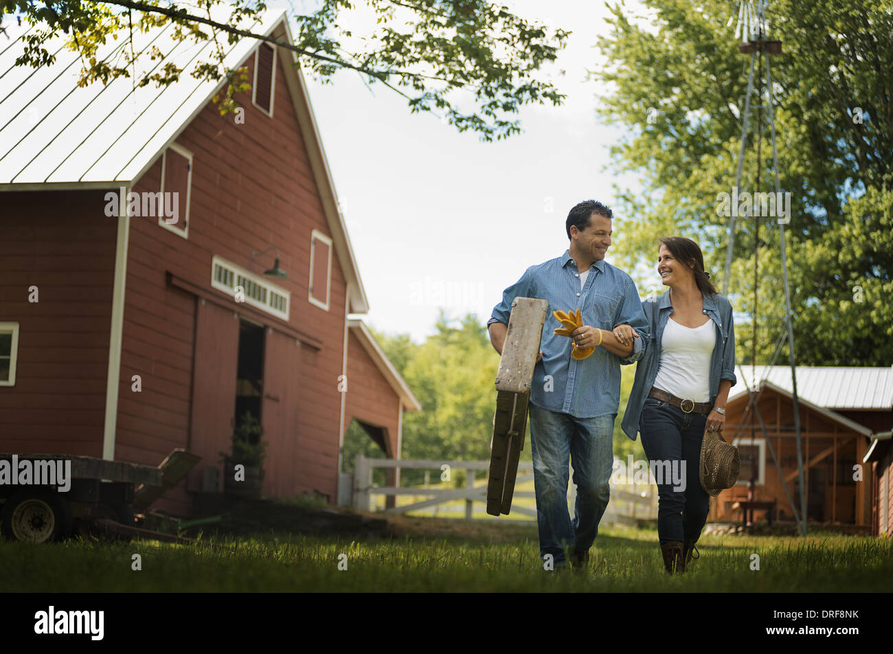 New York state USA Two people man and woman in yard traditional farm - Stock Image