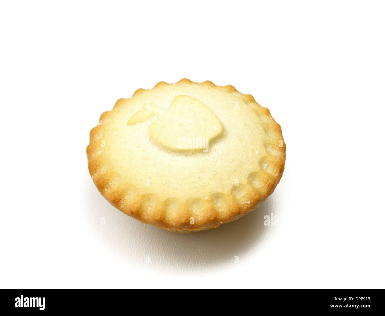 Small whole individual Bramley apple pie with apple shaped design isolated on a white background. England, UK, Britain - Stock Image