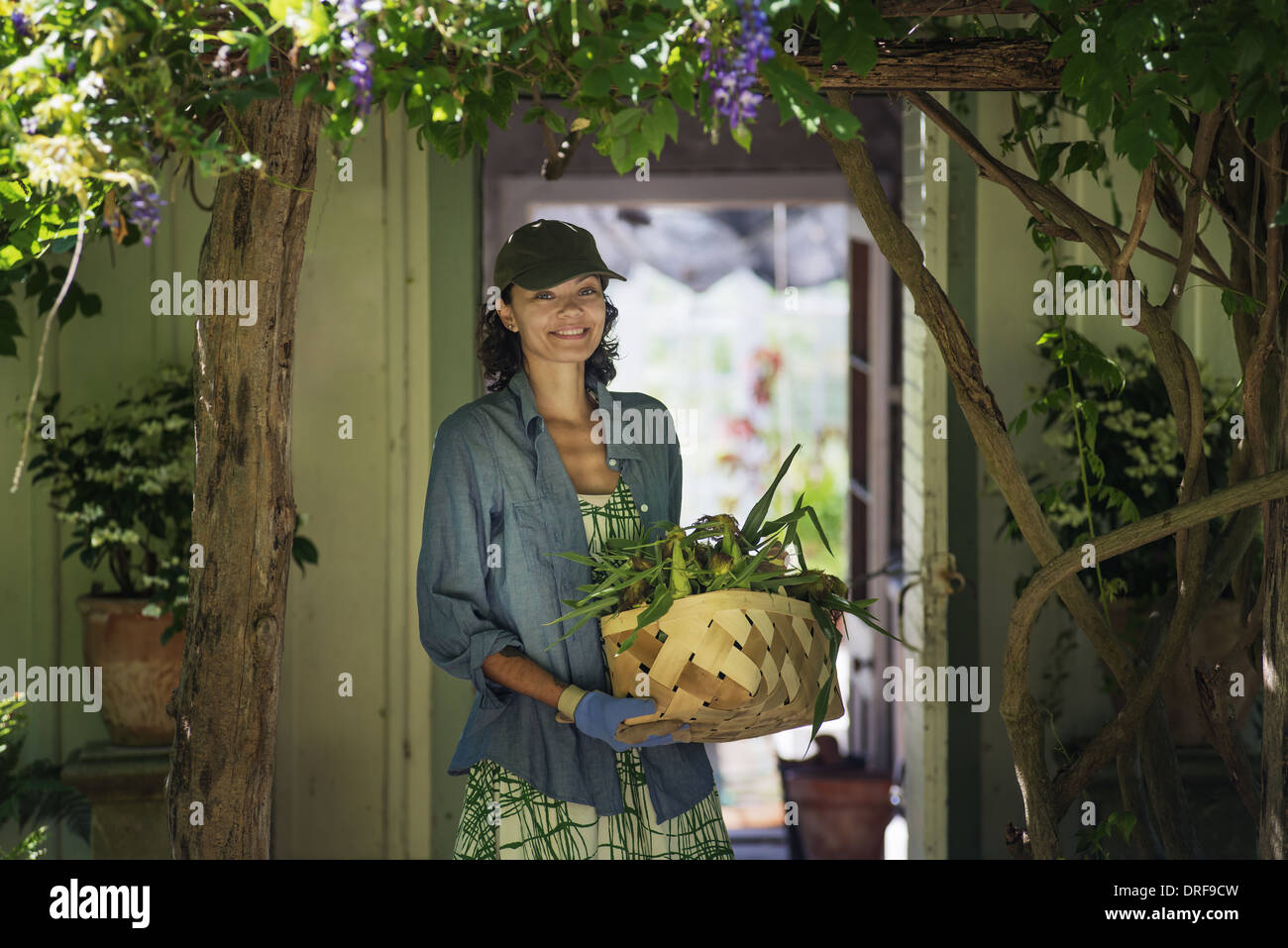 New York state USA young woman in farmhouse kitchen with large window Stock Photo