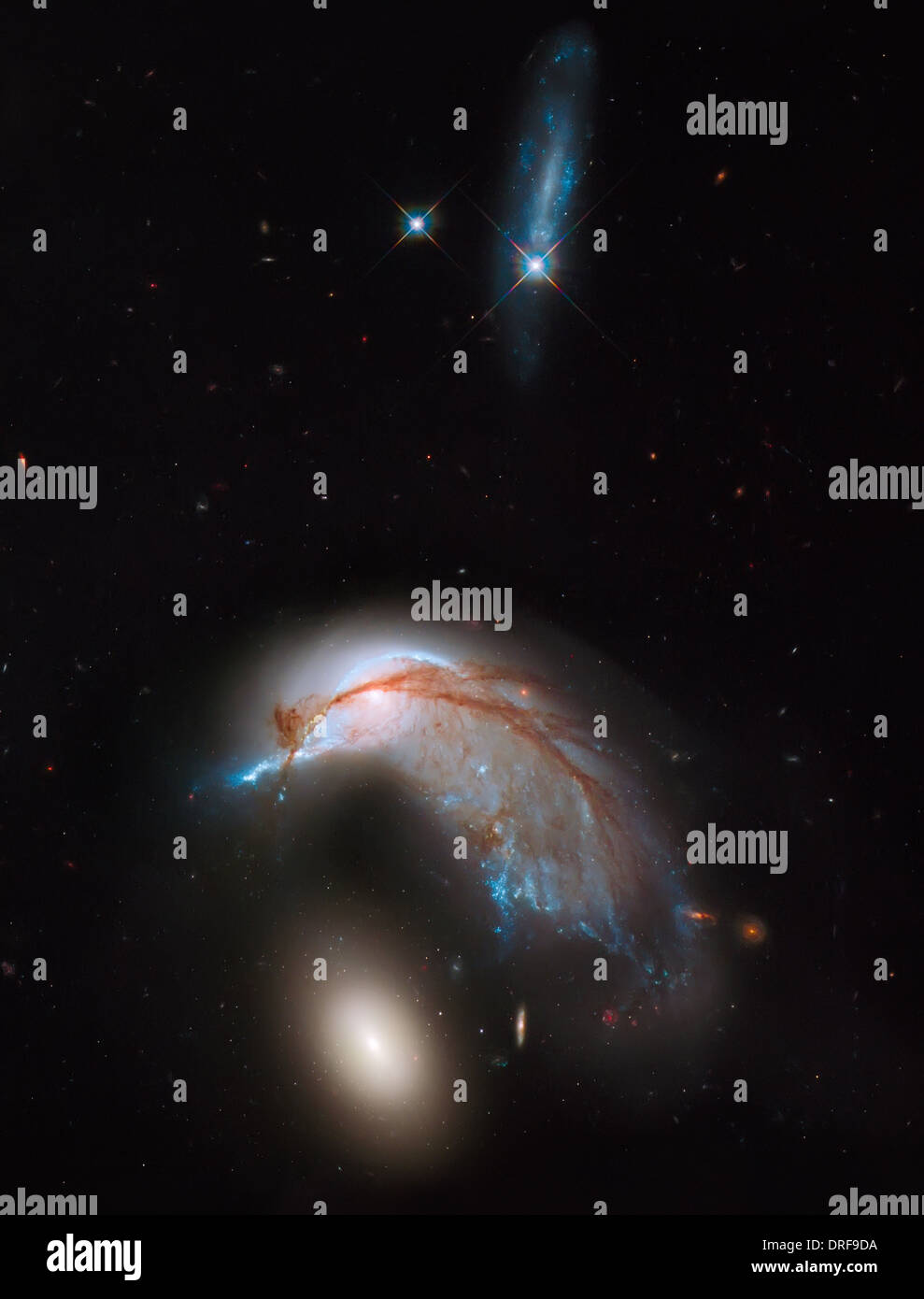 Arp 142 galactic merger, as shown in a photo from  Hubble Space Telescope. - Stock Image