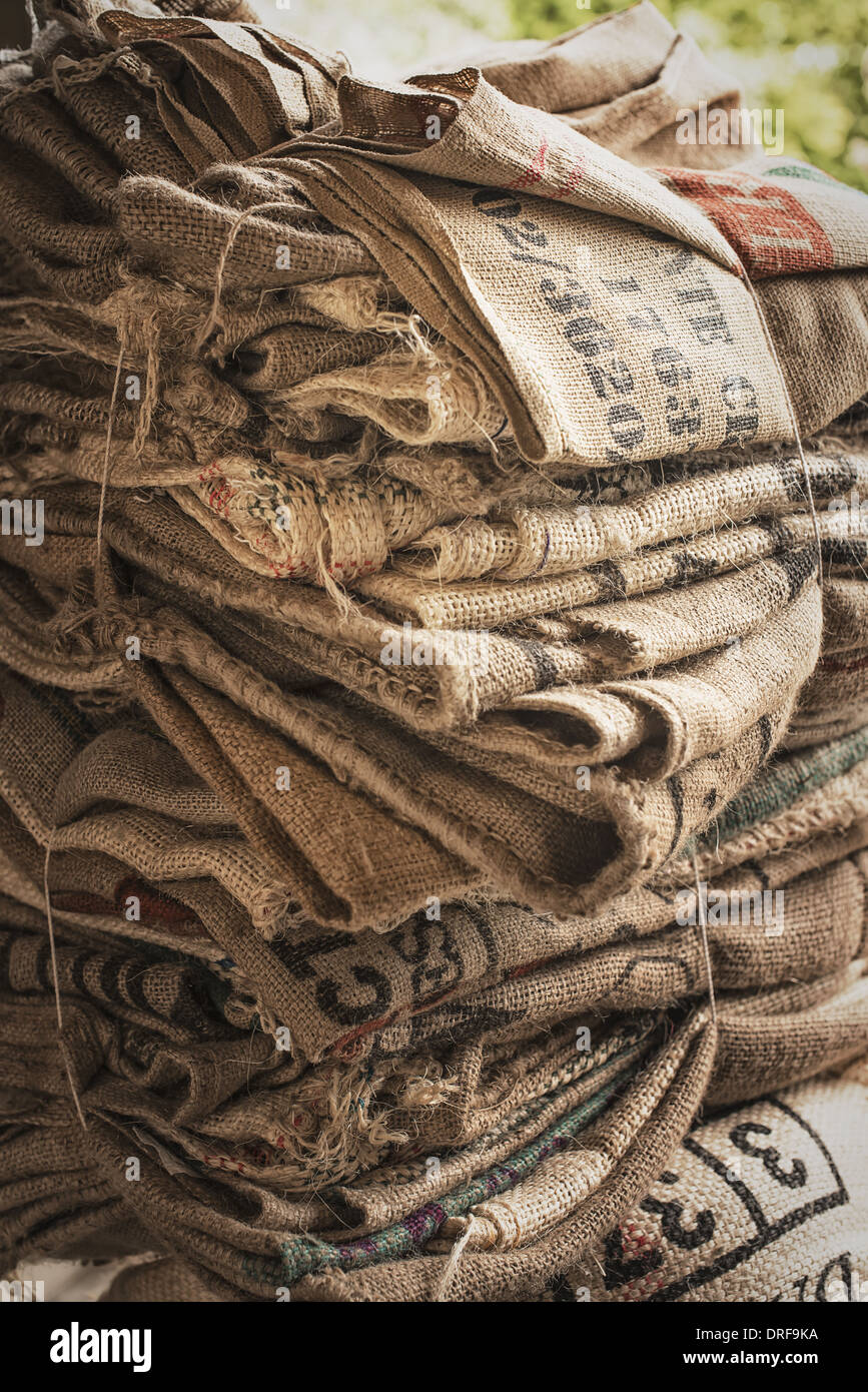 New York state USA pile of empty stamped hessian sacks bundled reuse Stock Photo