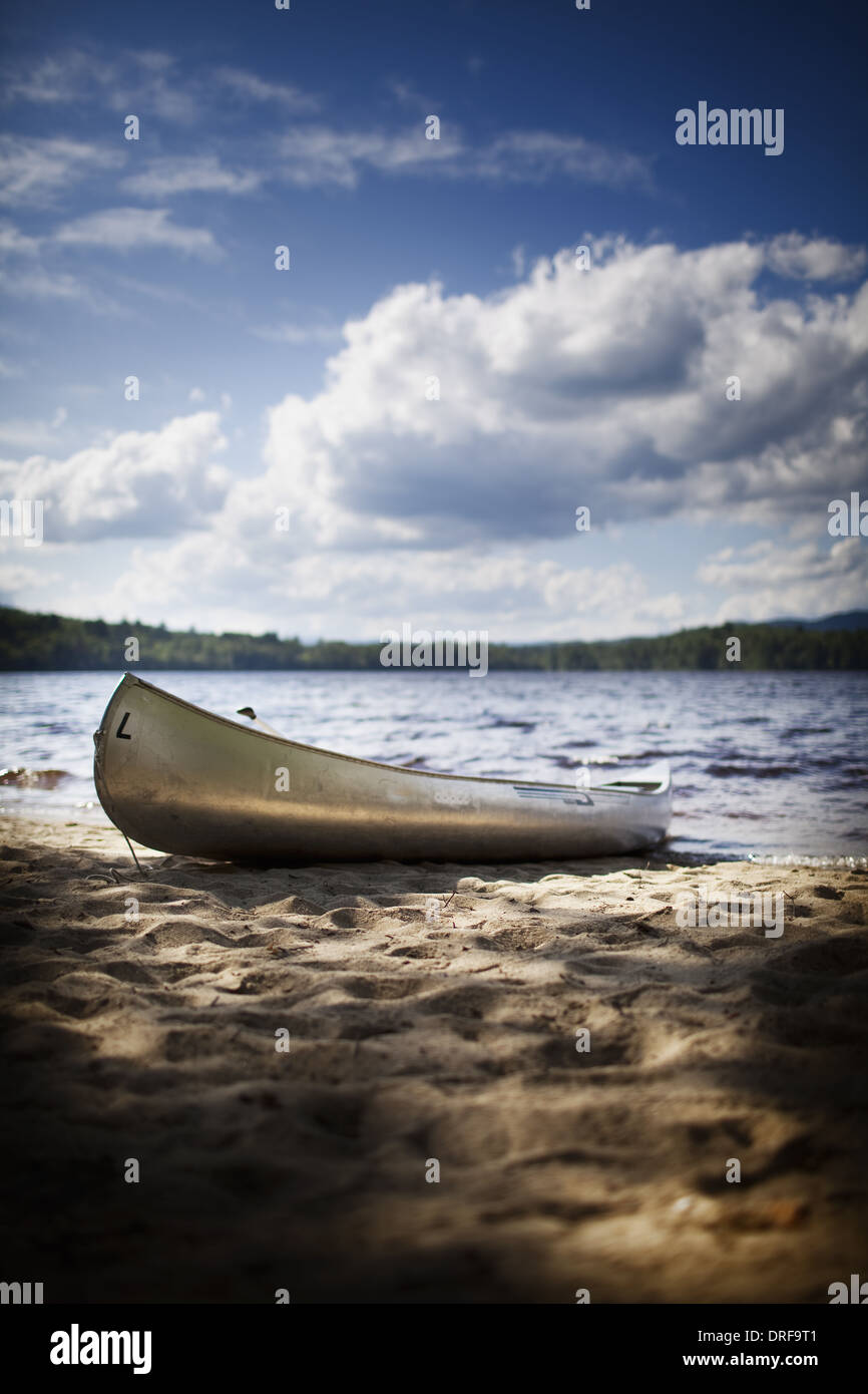USA canoe boat beached on the shore of lake or river - Stock Image