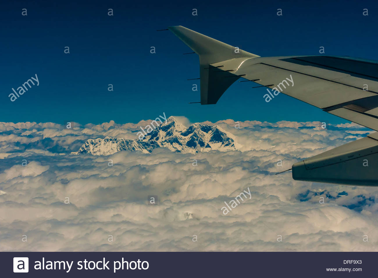 Aerial view of Mt. Everest (the tallest mountain in the world at 29,029 feet) in the Himalayas on a flight between Kathmandu, Nepal and Lhasa, Tibet (China). - Stock Image