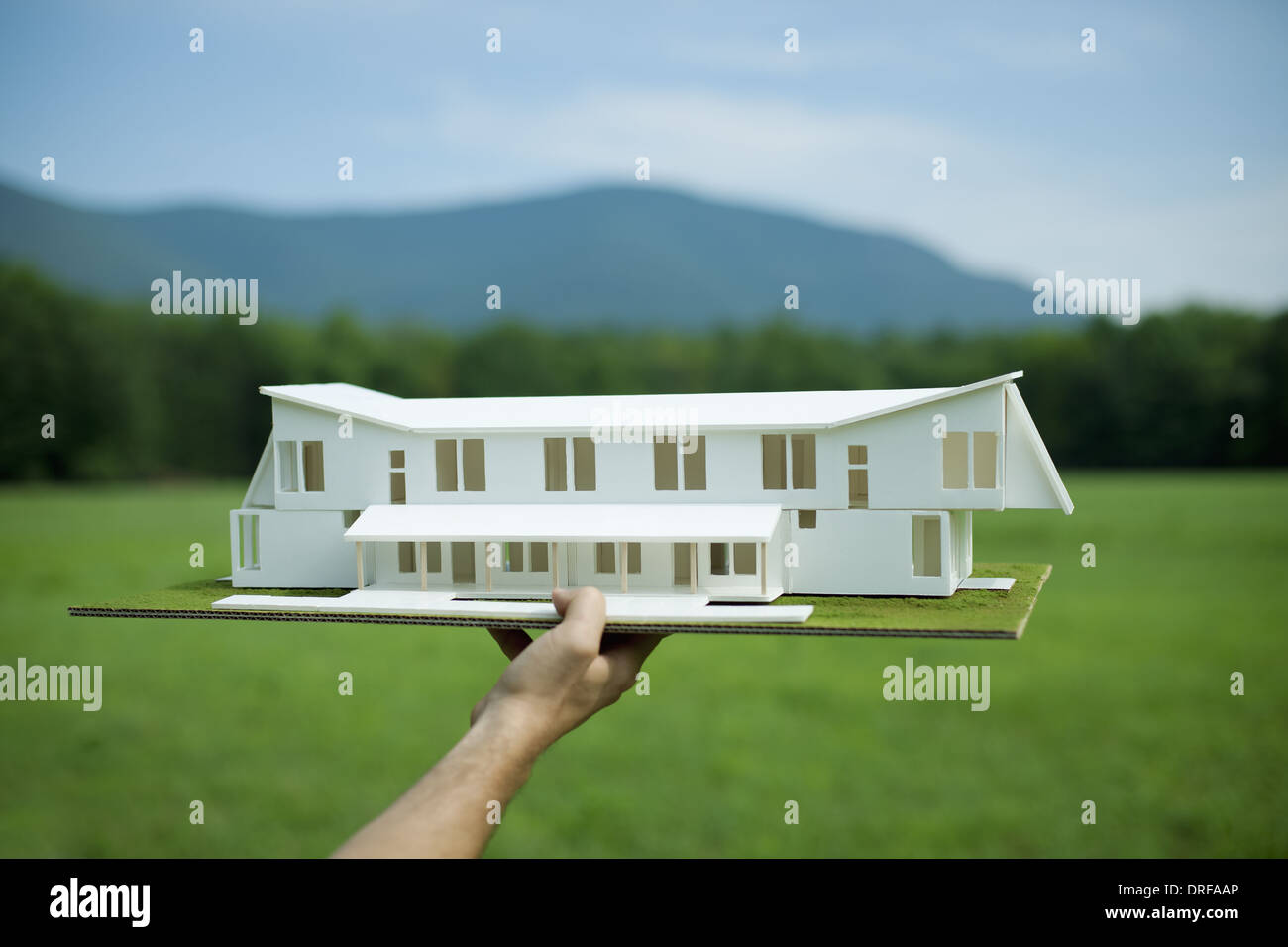 New York state USA rural person holding scale model of new building Stock Photo