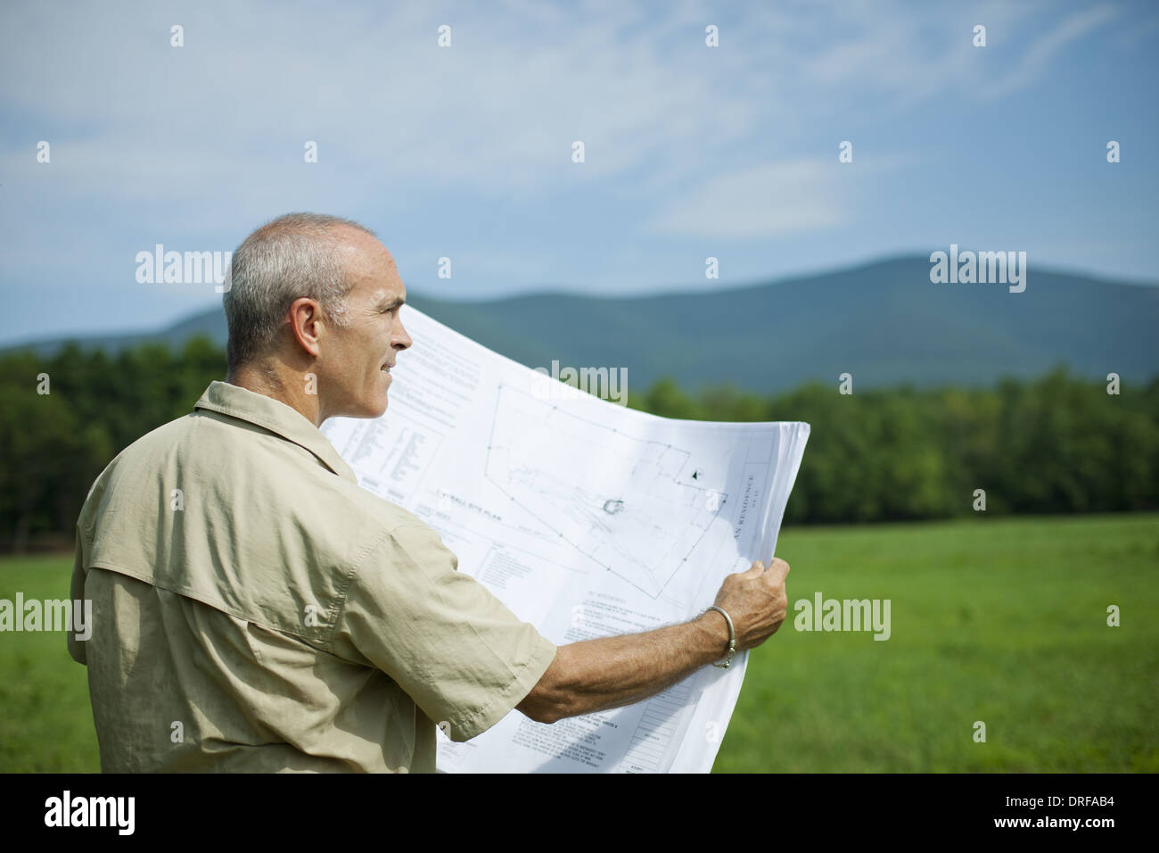 New York state USA rural person holding scale model of new building - Stock Image